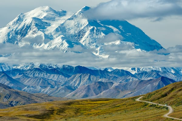 Park Road leads into Thoroughfare pass with Denali (AKA: Mt. McKinley) in background  in Denali National Park.  August  Summer/early fall-autumn.  Interior, Alaska