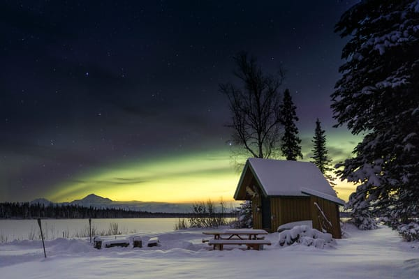 Winter landscape of Denali (Mt. Mckinley) and Northern Lights (Aurora Borealis) in sky with cabin at North Country Bed and Breakfast   Photo by Jeff Schultz/SchultzPhoto.com  (C) 2016  ALL RIGHTS RESVERVED