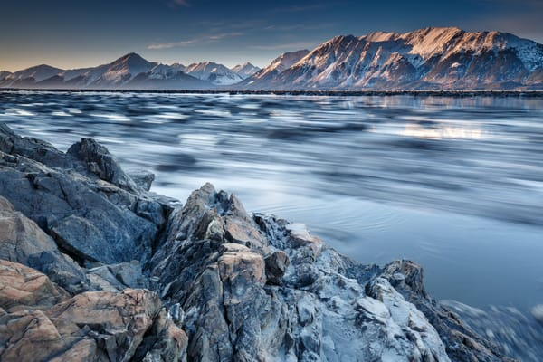 spring landscape of ice moving as tide retreats along Turnagain Arm with Kenai Mountains in Southcentral, Alaska  April 2017  Photo by Jeff Schultz/SchultzPhoto.com  (C) 2017  ALL RIGHTS RESERVED