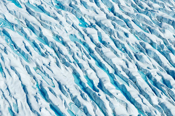 Spring landscape detail of Knik Glacier crevasses and blue pools of water. Aerial  Photo by Jeff Schultz/  (C) 2020  ALL RIGHTS RESERVED