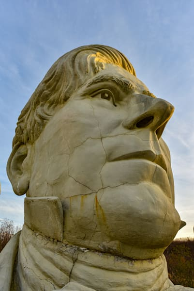 Unique angle of a president statue from the Ruins of Presidents Park in Virginia.