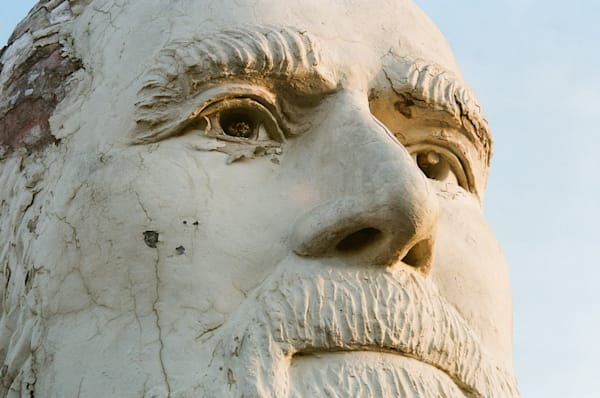 35mm film photograph of a close up a presidential statue at the Ruins of Presidents Park in Virginia.