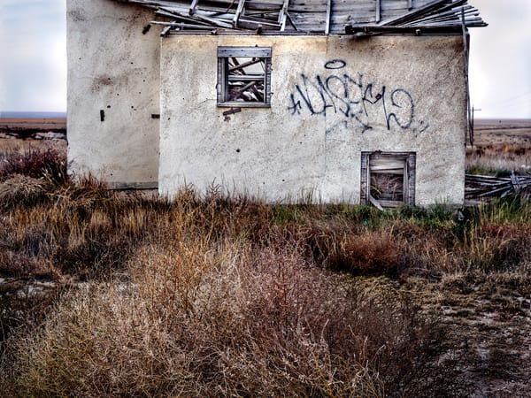 Titled: Western Kansas Stucco. Americana fine art color photograph by nationally recognized fine art photographer, David Zlotky