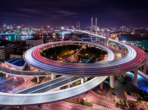 A stunning long exposure night photograph of Nanpu Bridge at rush hour