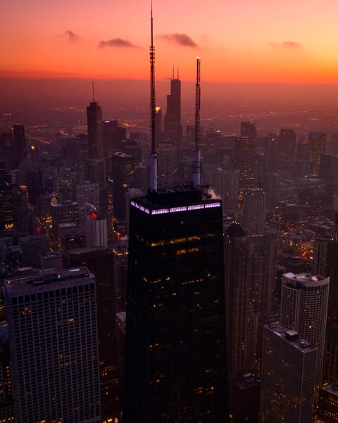 The sun sets over Hancock and Willis Tower.