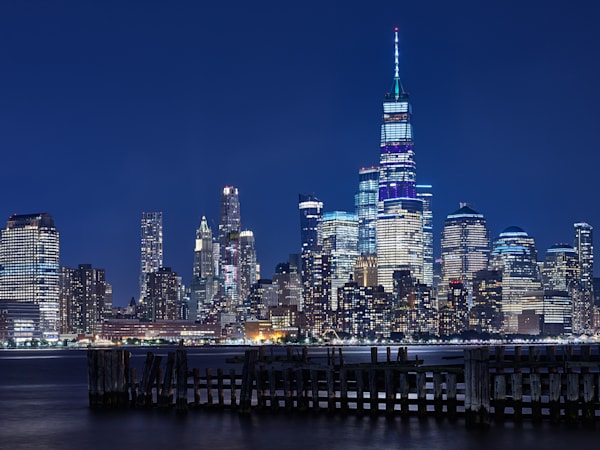 A limited edition, long exposure photograph of the NYC Freedom tower at night from Hoboken.