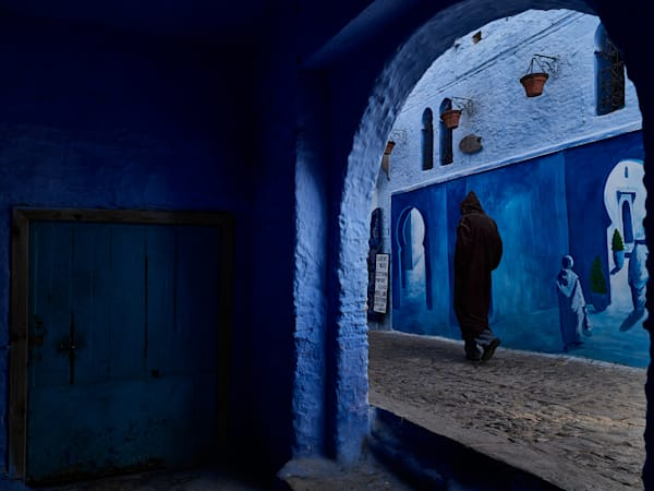 A limited edition moody street scene set against the blue walls of Chefchaouen, Morocco.