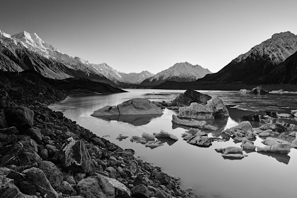 A timeless black and white photograph of Tasman Glacier with morning light on Mount cook on New Zealand's South Island.