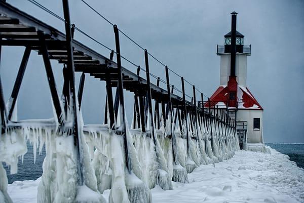 icy pier saint joseph lighthouse