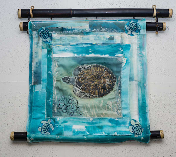 Mare Azul Tortuga by artist Muffy Clark Gill is a mixed media and batik collage