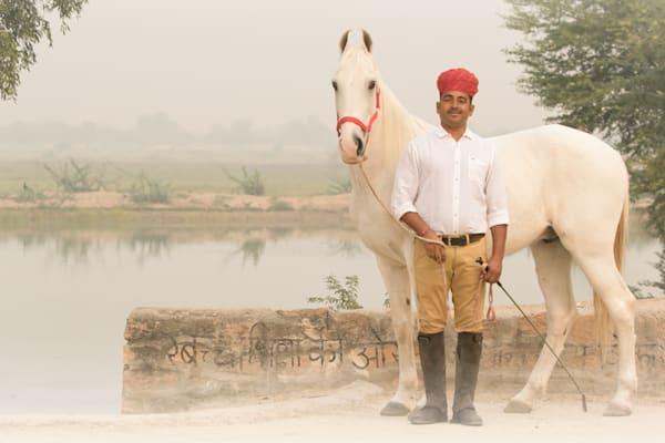 Horse Trainer poses with White Marwari Horse
