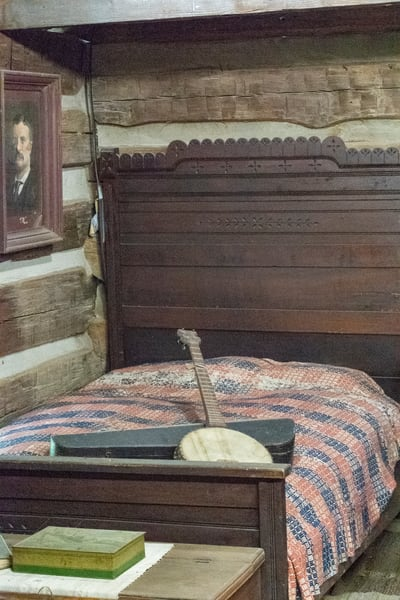 Banjo On Bed In Log Cabin Photography Art | Great Wildlife Photos, LLC