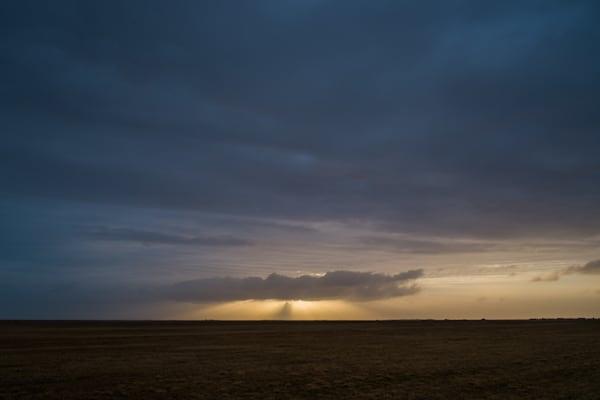 Sunbeams shine from behind dark clouds in Iceland