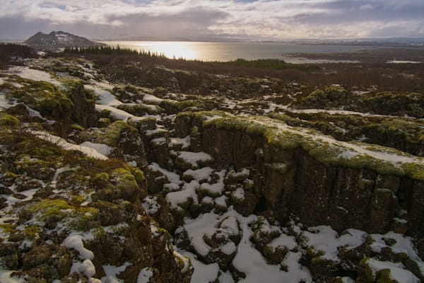 A volcanic canyon at sunset in Thingvellir National Park, Iceland