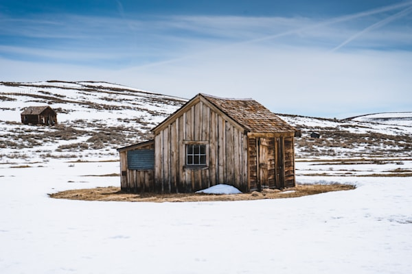 Little House on the Prairie - An old house in the snow in the Eastern Sierras photograph print