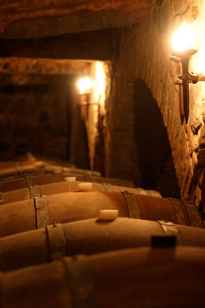 Wine cave with barrels of wine