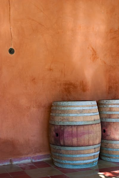 Wine barrel against adobe wall
