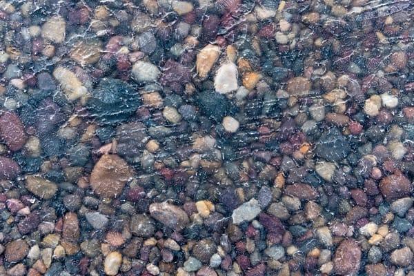 Frozen river rocks