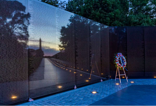 Vietnam Memorial with Reflection of Washington Monumnent at Sunrise