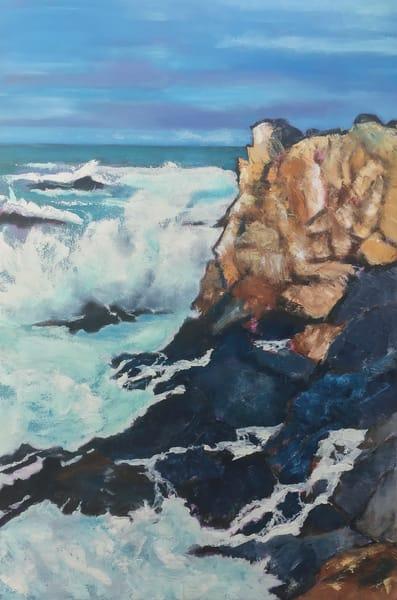 Waves crash into Mendocino County cliff.