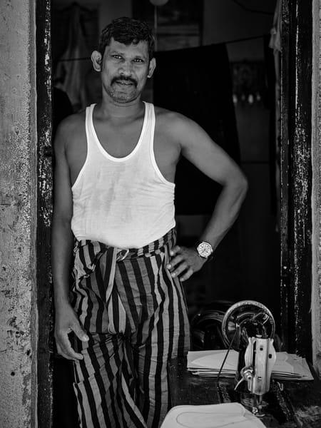 Timeless black and white street portrait of a shoemaker captured in Kandy, Sri Lanka.