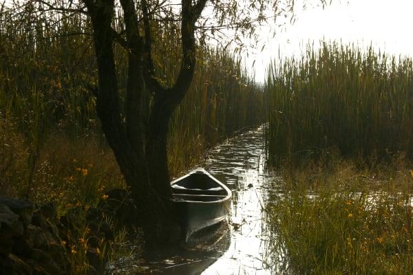 Canoe on Mexican river, Morelia landscape
