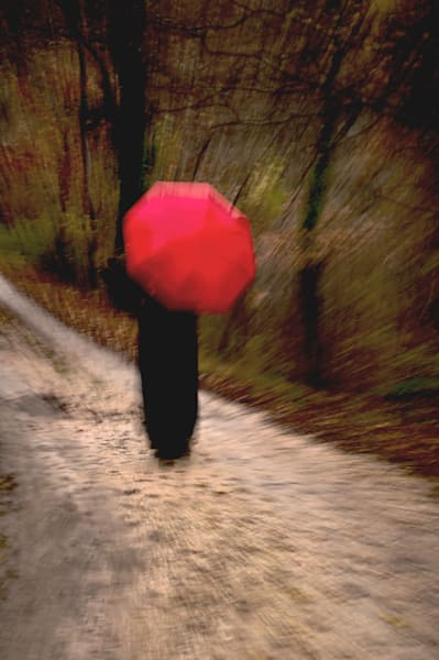 Woman with a Red Umbrella on a Country Road