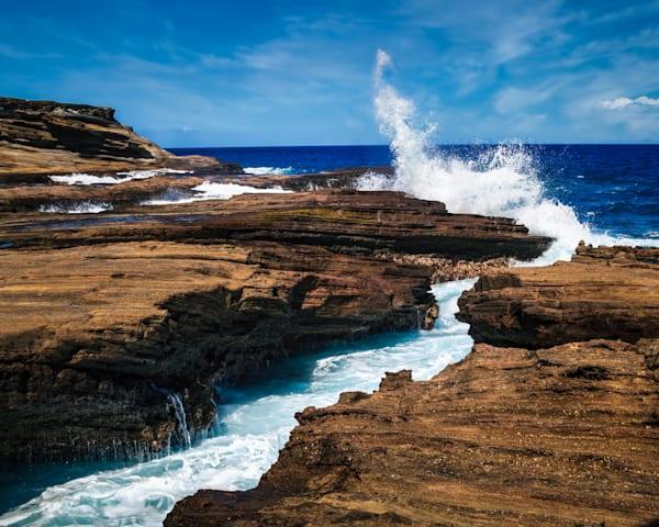 Crashing Waves Against Rocks