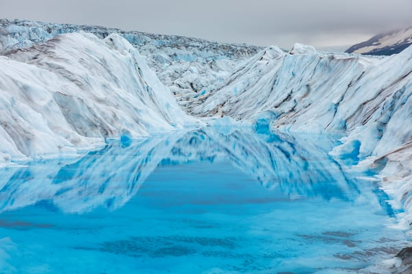 Summer landscape of blue pool of glacier water on Knik Glacier in SouthCentral, Alaska  Photo by Jeff Schultz/  (C) 2021  ALL RIGHTS RESERVED