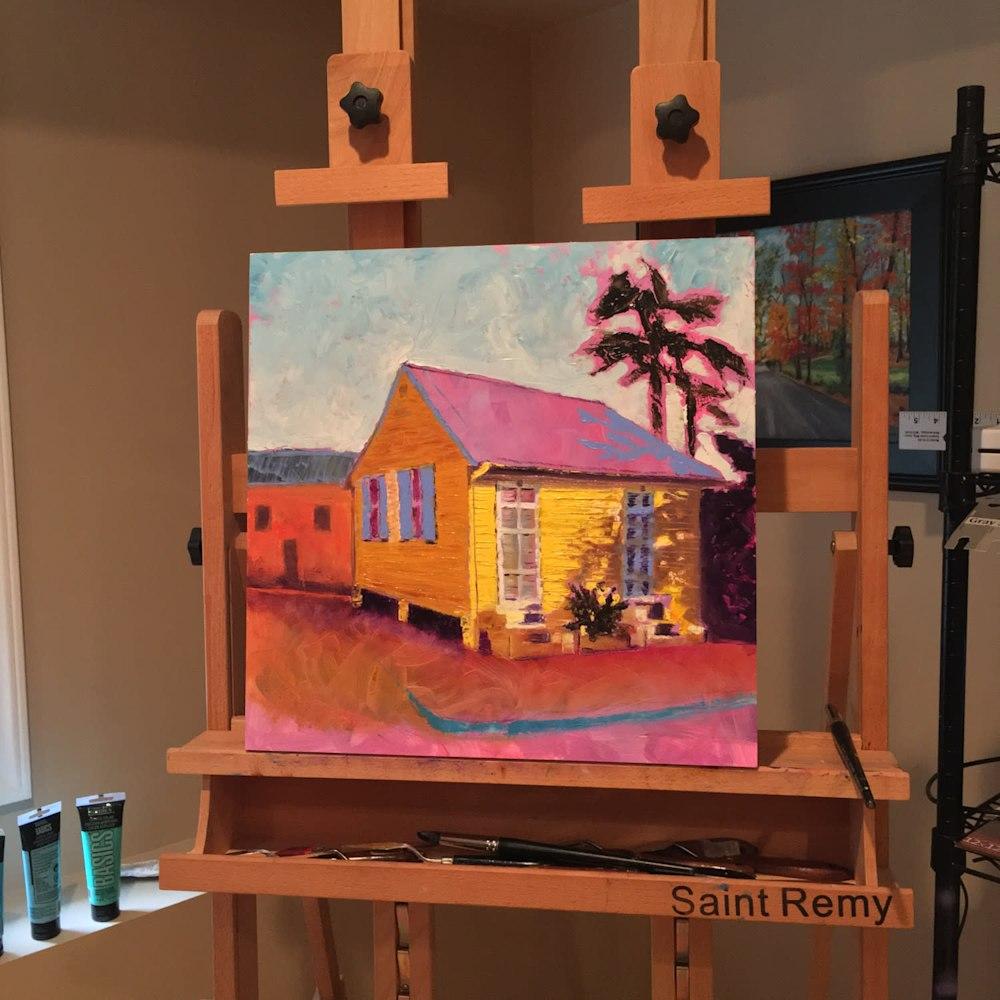 old-yellow-creole-house-easel-xpcgc3