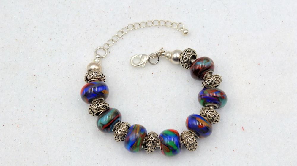Mark Lenn Johnson Lampwork glass blue green red bead bracelet $69