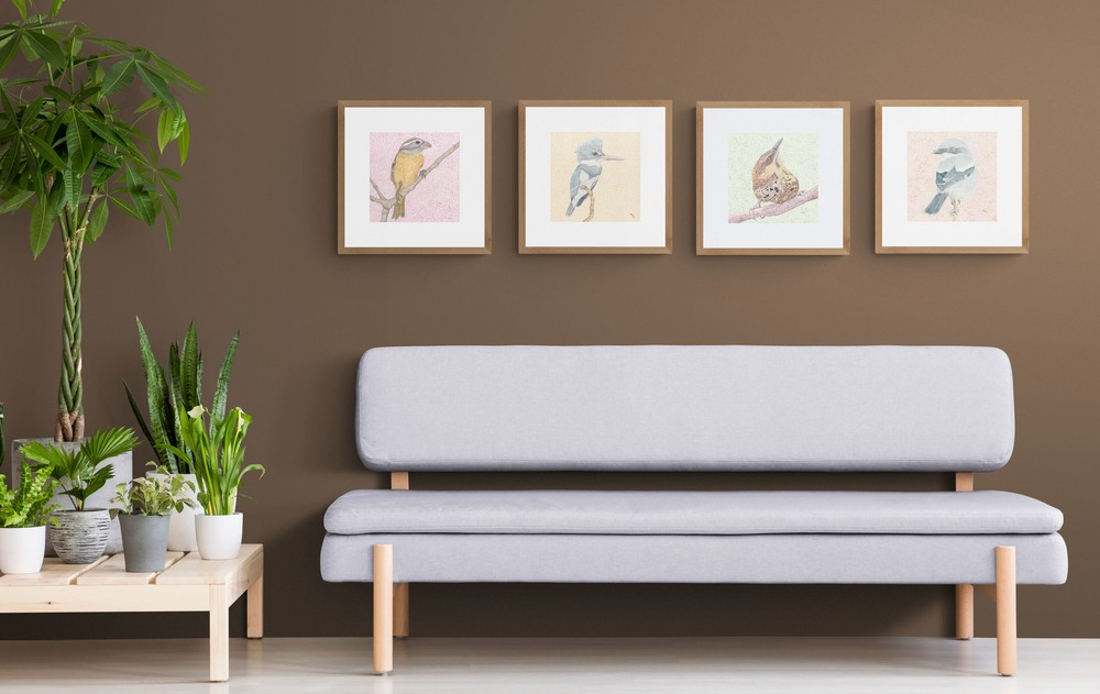 grosbeak and 3more sitting room with tropical plants