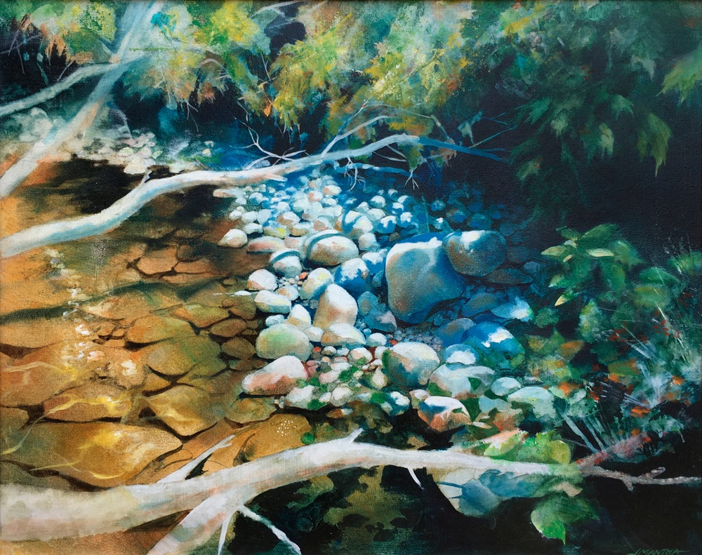 round pebbles on golden stream
