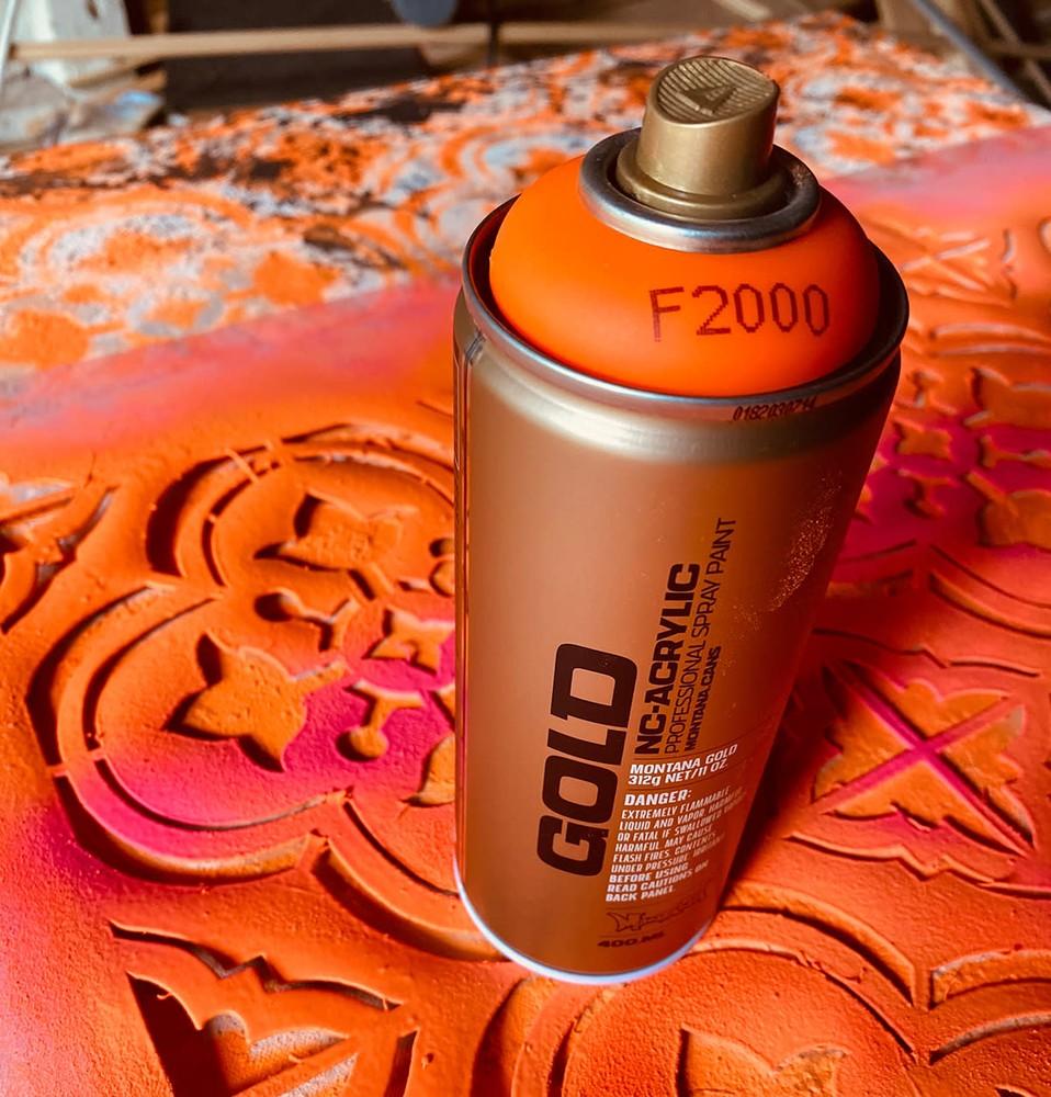 MICK orange stencil detail