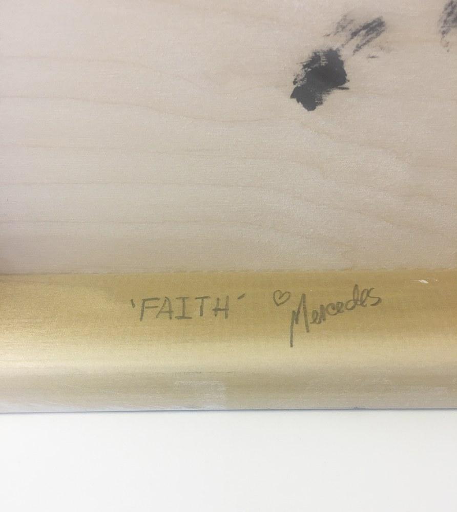Faith  signature on back