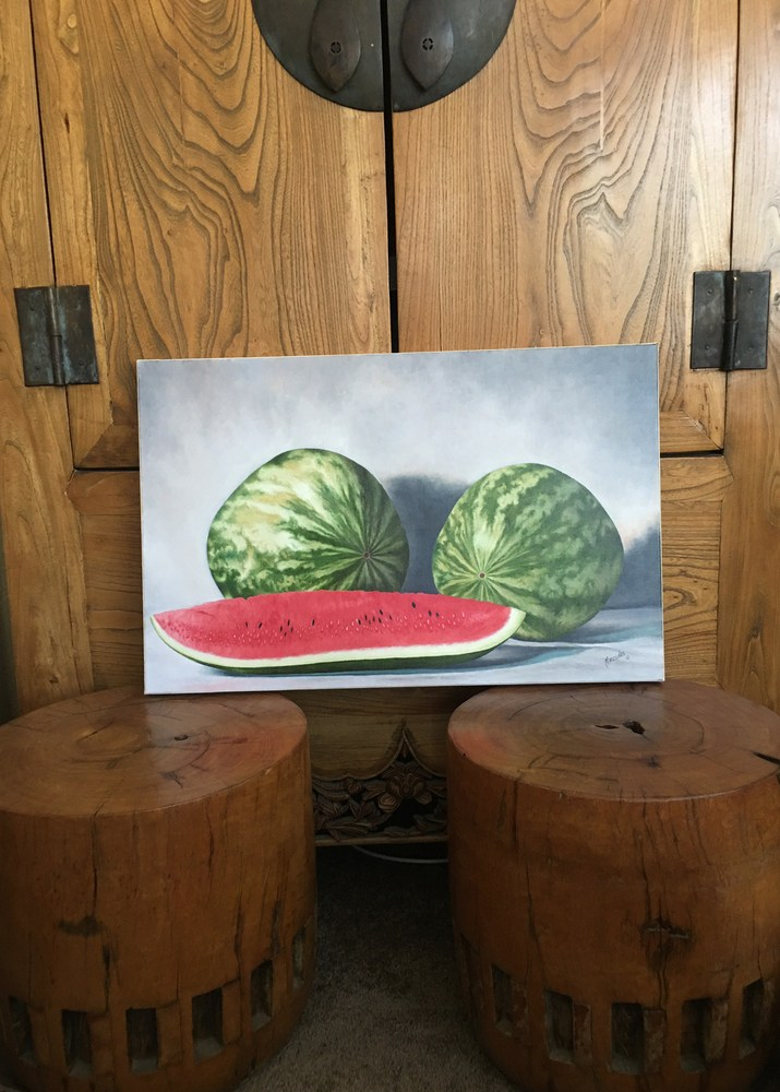 Watermelon  leaning against cab
