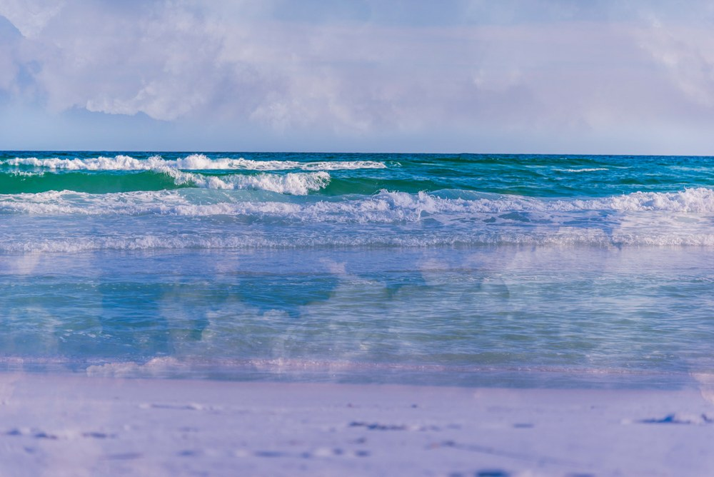 Photographic art of cloud reflections in the surf in Destin, Florida