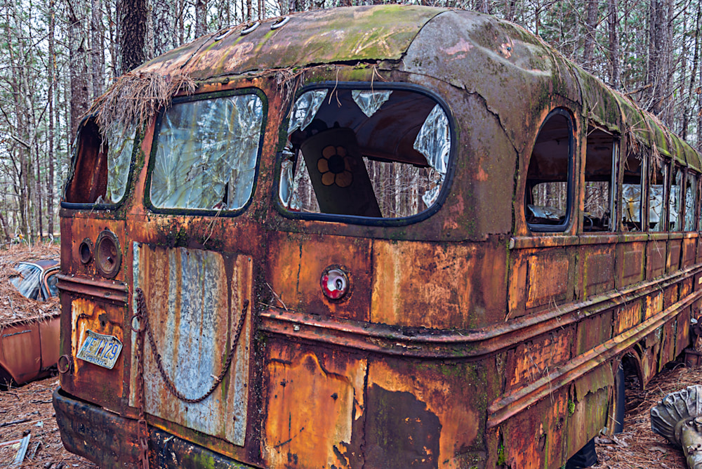 An old, busted-up, burned-out bus at Old Car City in Georgia