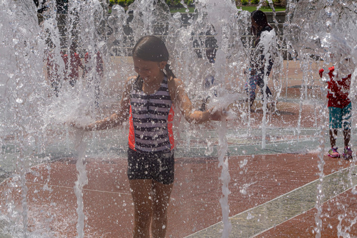 A photo of my niece playing in the Centennial Park fountain