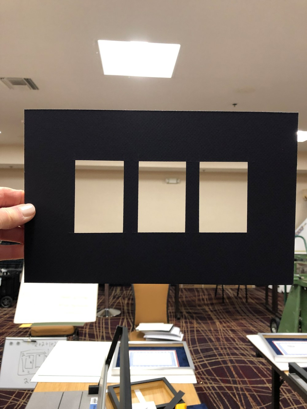 Learning to center 3 mat cuts at custom framing workshop
