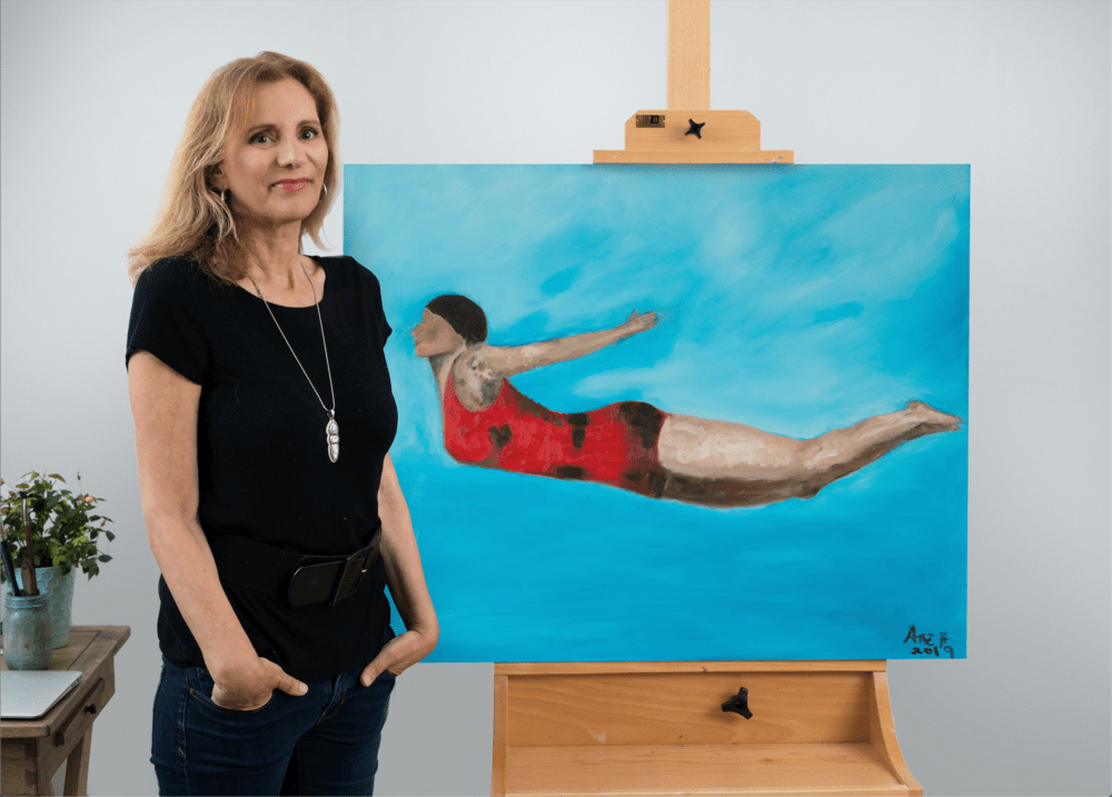 Ane Howard in front of The Diver, original oil painting for sale.