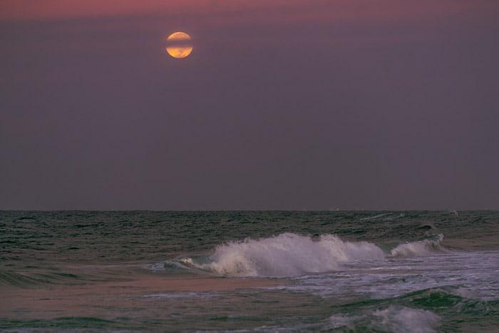 Full moon over the ocean in Destin