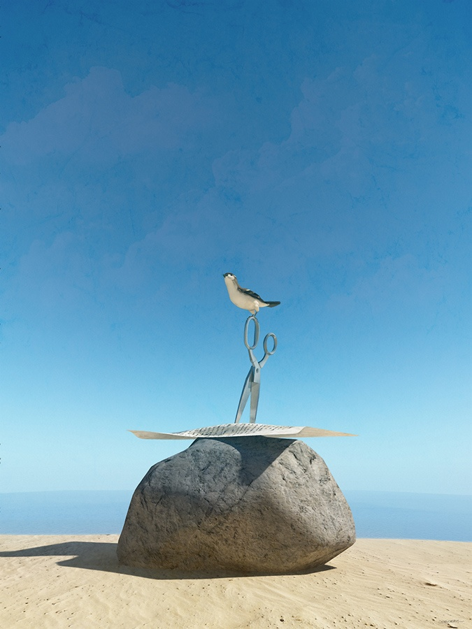 An image of a beach. In the foreground there is a rock with a sheet of paper on it, pinned down by a pair of scissors. A bird has landed on the handle of the scissors.
