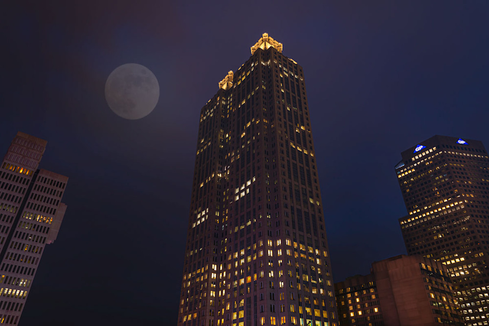 A full moon floats over downtown Atlanta