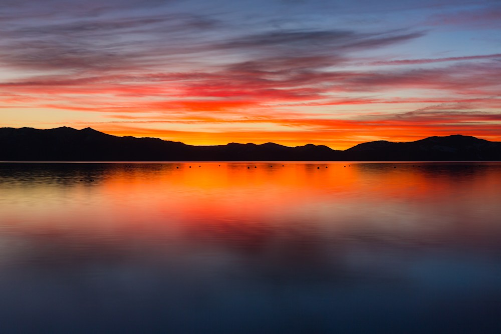 Sunset Reflections in Calm Waters.  East Shore.  Lake Tahoe.  Nevada.