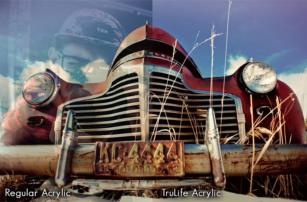 An image of a very old rusty chevy, worms eye view. The left half of the image has an overlay to appear reflective, while the other side does not