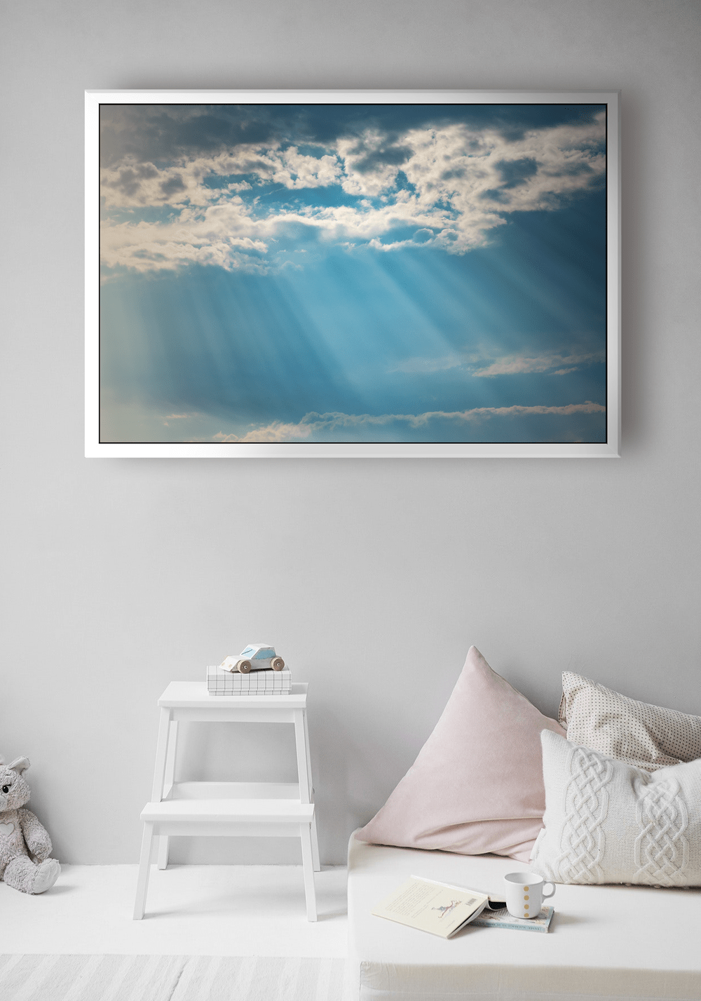 the final canvas image displaying a sunset sky hanging in a bedroom