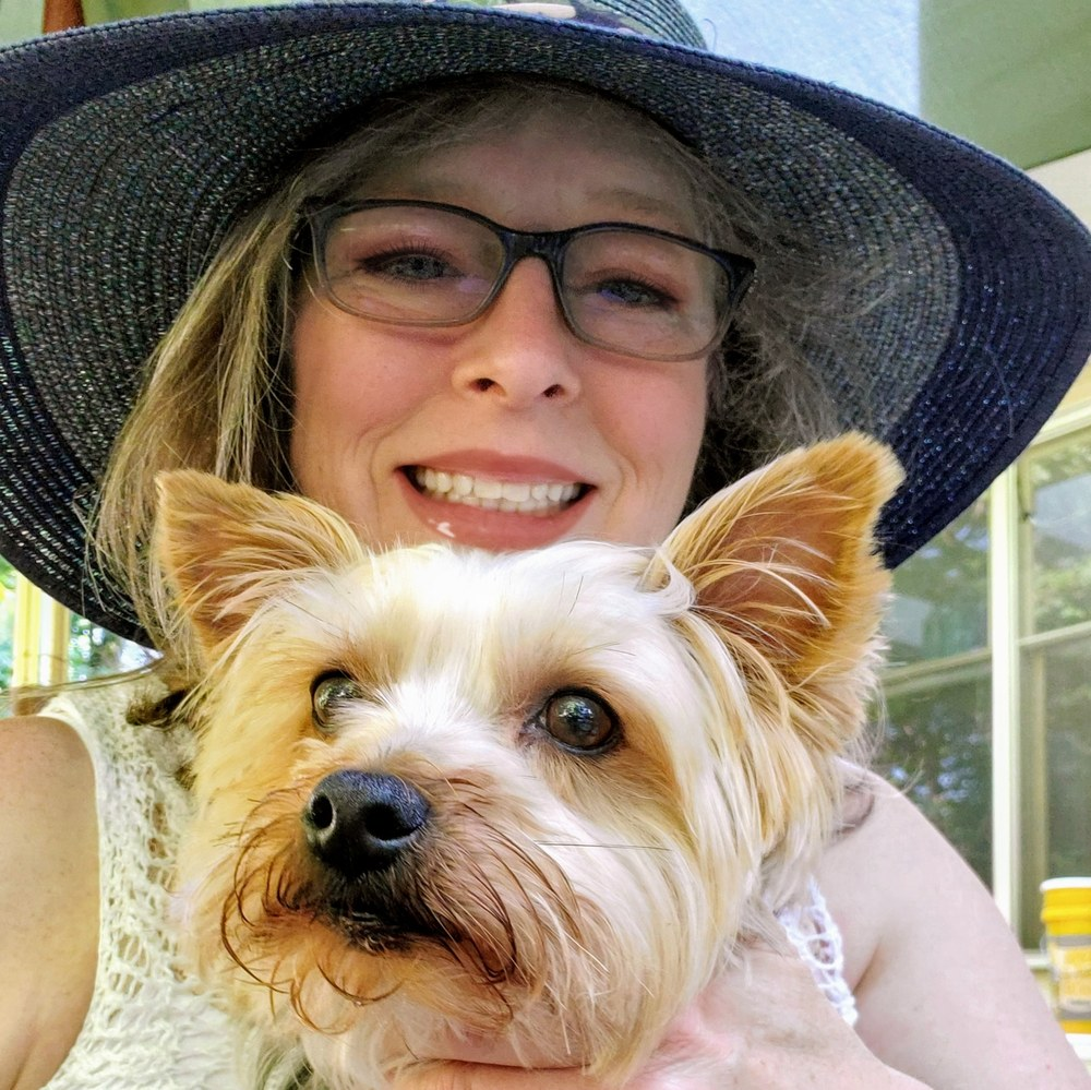 images of a woman and a Yorkshire terrier
