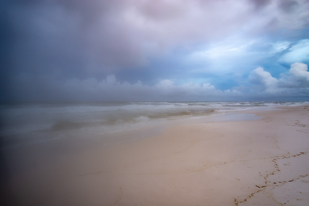 A humid hazy morning at the beach in Florida with pretty clouds and ocean view