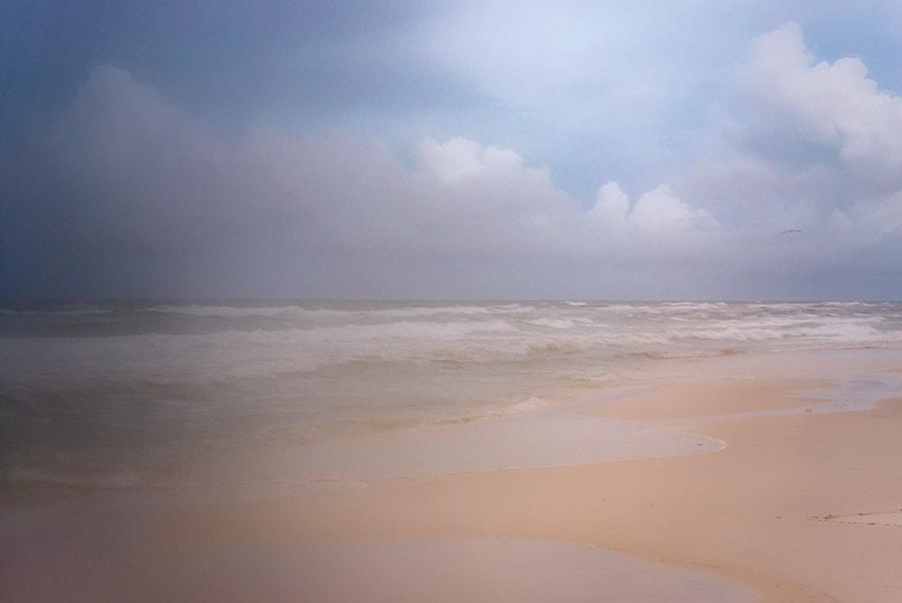 A painterly photo of the beach taken through a hazy lens